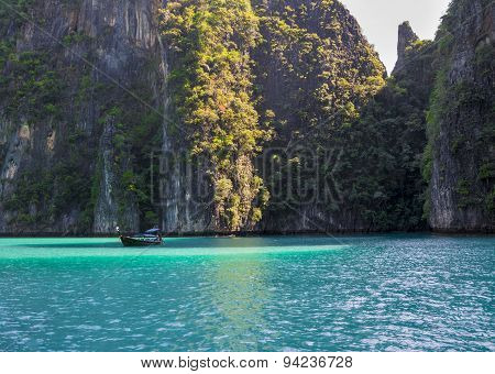 Phi phi island lagoon with a long tail boat