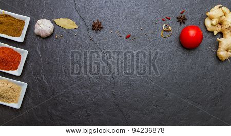 Mixed Spices And Herbs On Black Background.