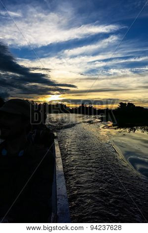 Sunset. Boat Crossing The Amazon.
