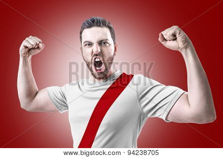 Peruvian soccer player celebrates on red background