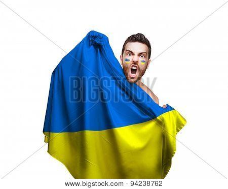 Fan holding the flag of Ukraine on white background