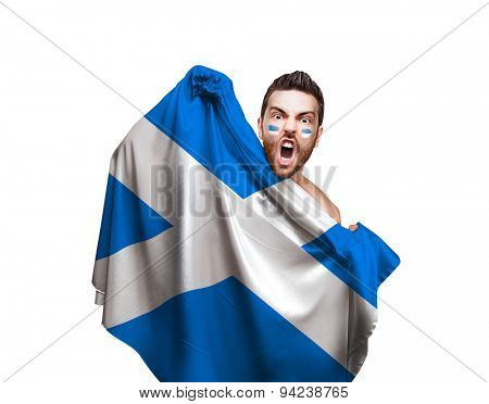 Fan holding the flag of Scotland on white background