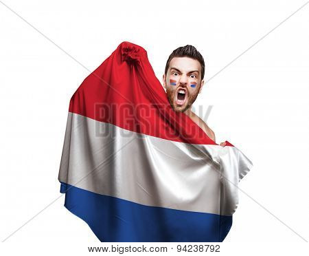 Fan holding the flag of Netherlands on white background