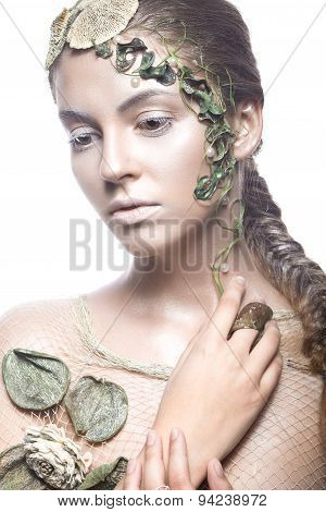 Beautiful fashionable girl in  image of sea fairies with shells and algae . Art beauty face.