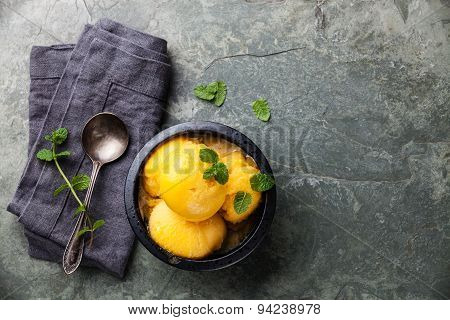 Mango Ice Cream Sorbet With Mint Leaves On Stone Slate Background