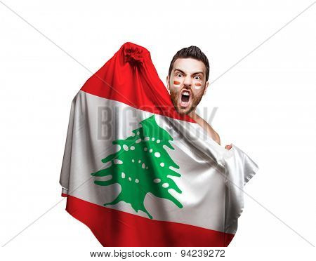 Fan holding the flag of Iran on Lebanon background