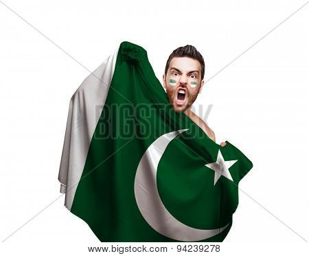 Fan holding the flag of Pakistan on white background