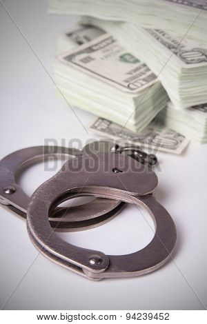 Bundle Of Dollars And Steel Handcuffs