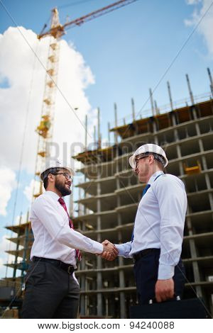 Two architects handshaking after making agreement