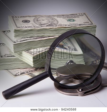 Packs Of Dollars With Magnifier And Handcuffs