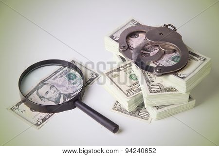 Dollars, Magnifier And Handcuffs