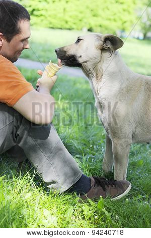 Man Feeding The Dog Ice Cream