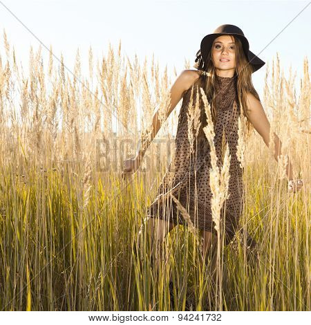 Sunrise Shot Of A Beautiful Young Model In Tallgrass Meadow