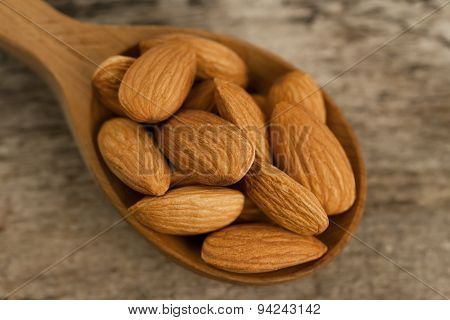 Peeled Almonds In Spoon On Wooden Background. For Vegetarians