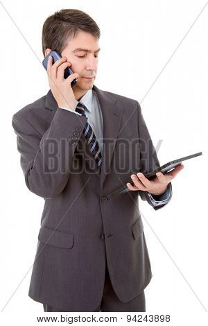 businessman using touch pad of tablet pc, on the phone, isolated