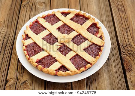 Lattice Round Cake With Strawberry Jam On Wooden Background