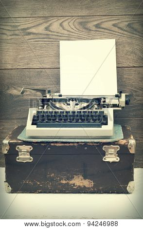 Typewriter On Wooden Background