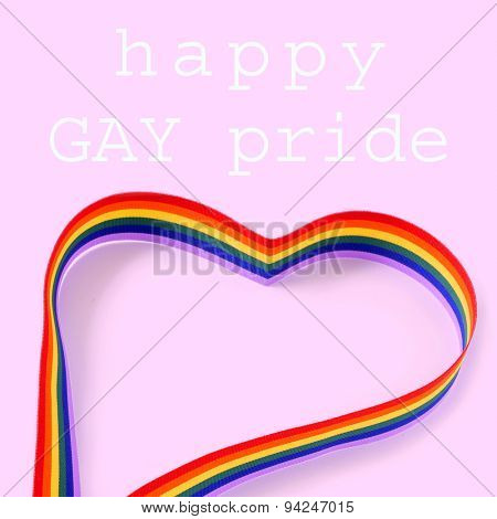 a rainbow ribbon forming a heart and the text happy gay pride day