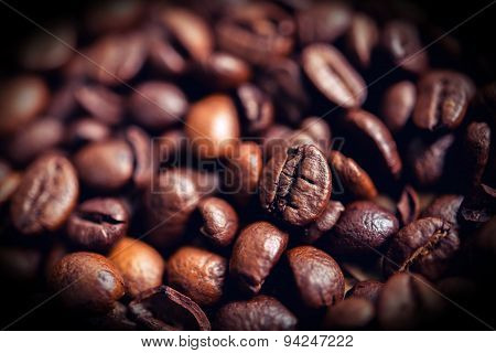 Coffee Beans On Wooden Table On Brown Background