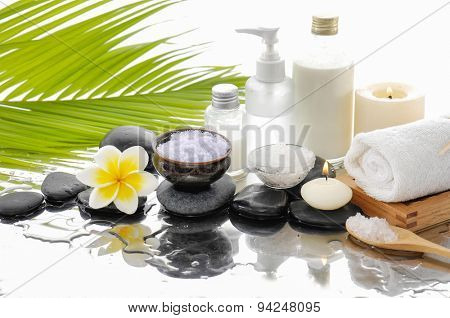 spa concept with palm ,towel, salt in bowl ,stones, candle