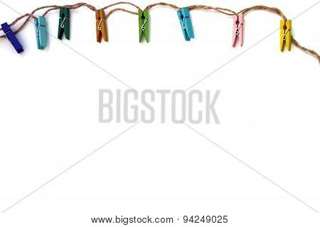 Background Of Colored Linen Clothespins Isolated On White