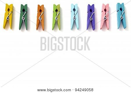 Background Of Multi Colored Linen Clothespins Isolated On A White