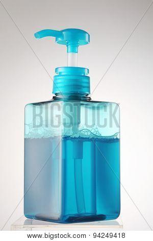 blue color soap in the dispenser