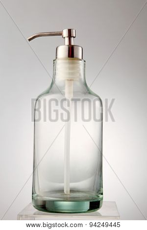empty glass dispenser on the white background