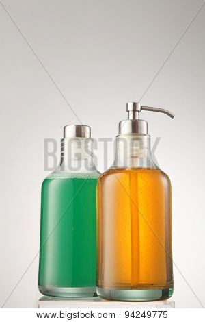 cleanser and shampoo in the glass container