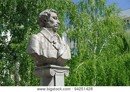 Alexander Pushkin Monument In Orel, Russia With Green Willows On The Background