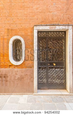 Entrance of an apartment building in Burano, Venice, Italy.