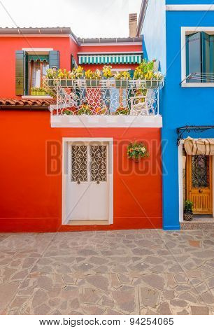 Entrance of a colorful apartment building in Burano, Venice, Italy.