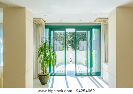 Entrance of a large luxury dining room interior. New empty hotel or home space.