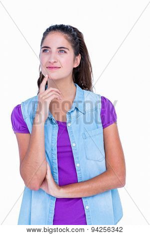 Pretty brunette thinking with finger on chin on white background