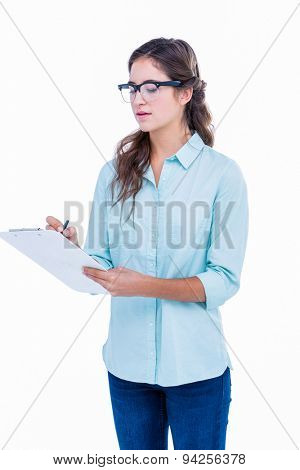 Pretty geeky hipster writing on notebook on white background