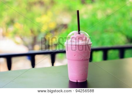 Pink Milk Shake On Wooden Table On Geen Background