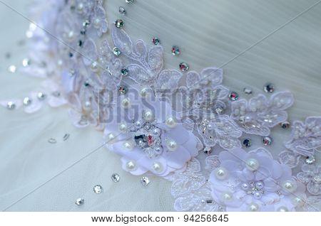 Beautiful lace with flower pattern on a wedding dress - macro photo