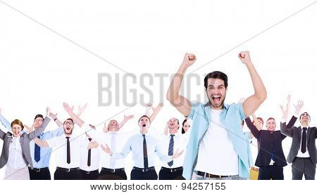 Composite image of happy casual man cheering at camera with arms raised
