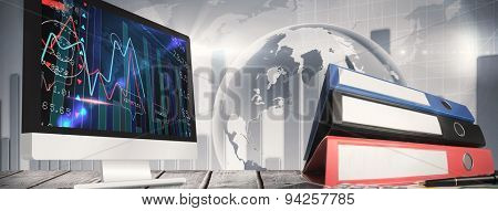 Computer screen against stocks and shares