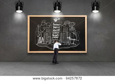 Thinking businessman touching chin against blackboard with copy space