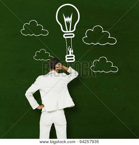 Thinking businesswoman against green