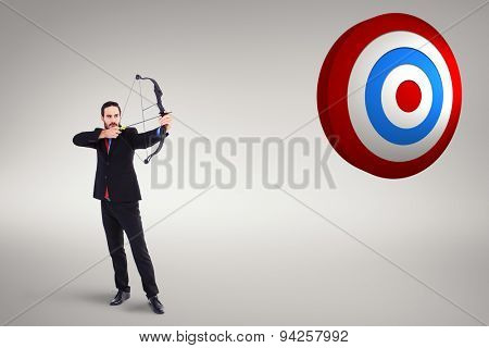 Focused businessman shooting a bow and arrow against white background with vignette