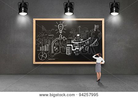 Businesswoman scratching her head against blackboard with copy space