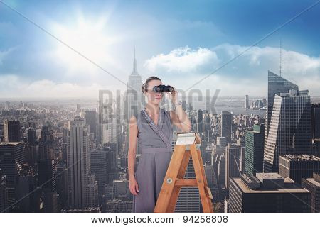 Businessman looking on a ladder against sunny city view