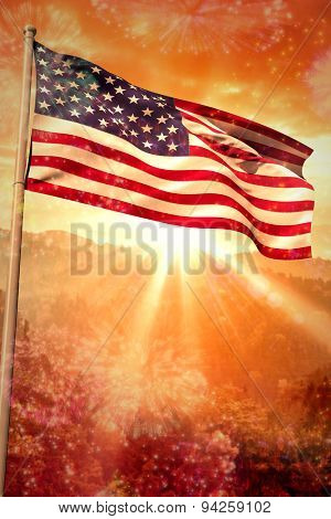 USA national flag against colourful fireworks exploding on black background