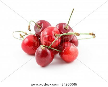 Pile of wild cherries isolated on white