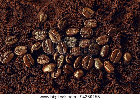 Coffee Beans On Coffee Grounds