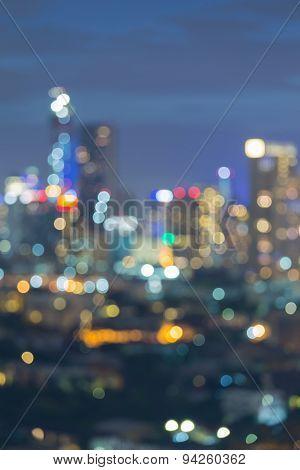 Defocusing background of city lights at night