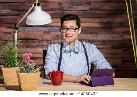 Flattered Woman At Desk