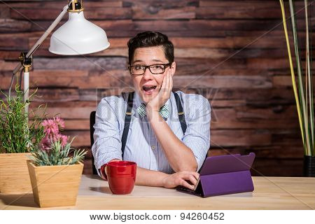 Excited Woman At Desk